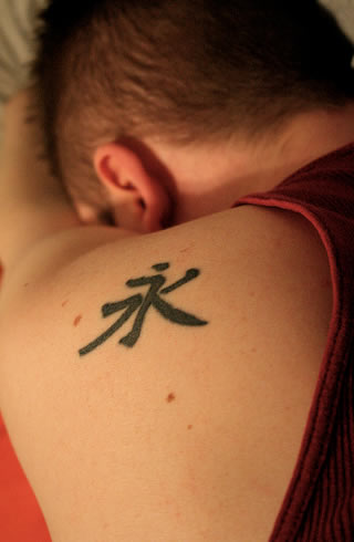 these tattoos on Americans with Chinese symbols for words like love,